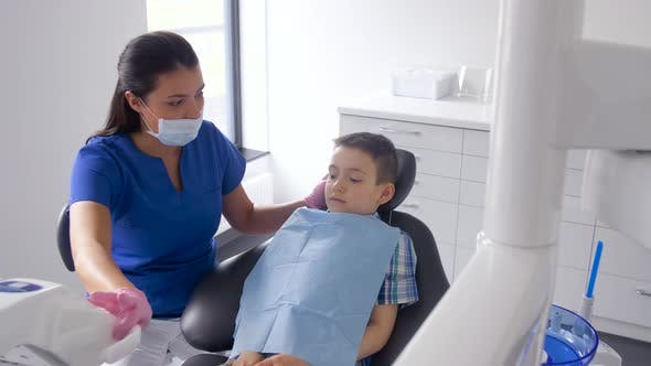 Thumbnail for Female Dentist with Kid Patient at Dental Clinic