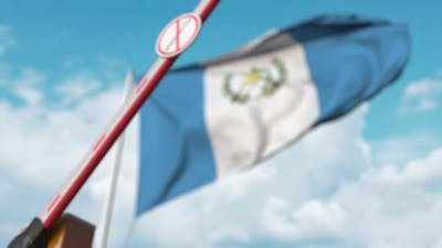 Barrier with No Immigration Sign Closed at Flag of Guatemala