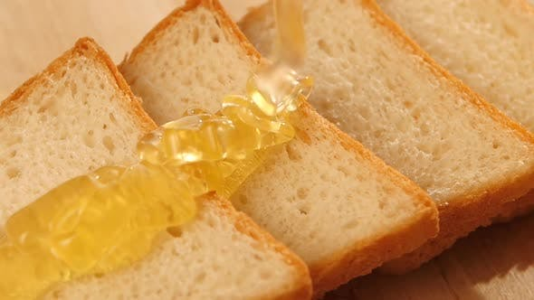 Thumbnail for Toasted Bread with Flowing Down Honey on Wooden Bred, Slow Motion
