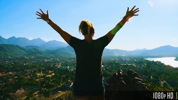 Thumbnail for Back View of Excited Successful Woman Raising Arms While Enjoying View of Luang Prabang, Laos