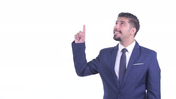 Happy Bearded Persian Businessman Pointing Up