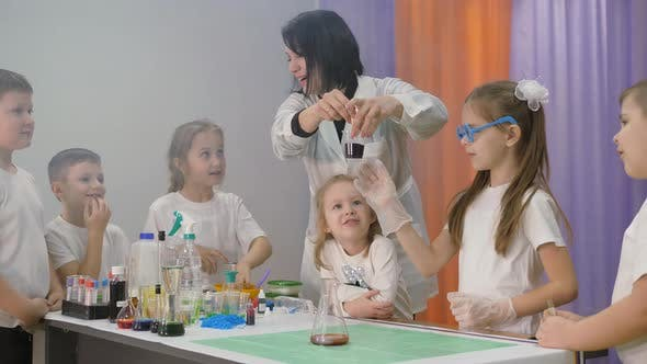 Thumbnail for Chemical Experiments for Children. Pouring and Mixing the Ingredients in the Flasks. Fun Experiments