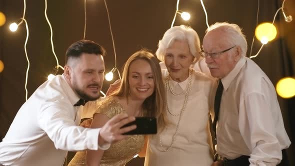 Thumbnail for Happy Family Taking Selfie at Party