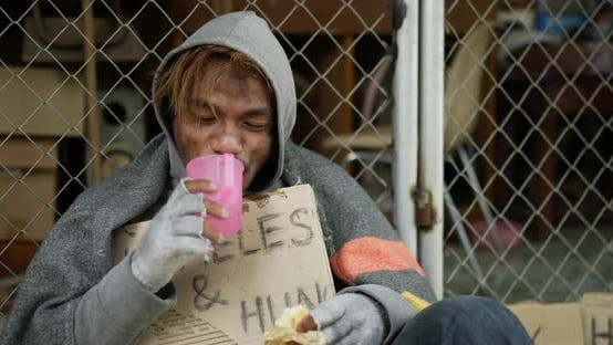 Homeless getting food from kind people