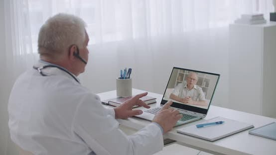 Thumbnail for Cardiologist Is Consulting Elderly Patient Online, Man Is Calling at Hospital To His Attending