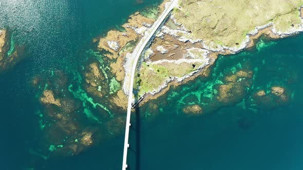 Thumbnail for Scenic Aerial Footage of Beautiful Road with Bridge on the Island Smola, Norway