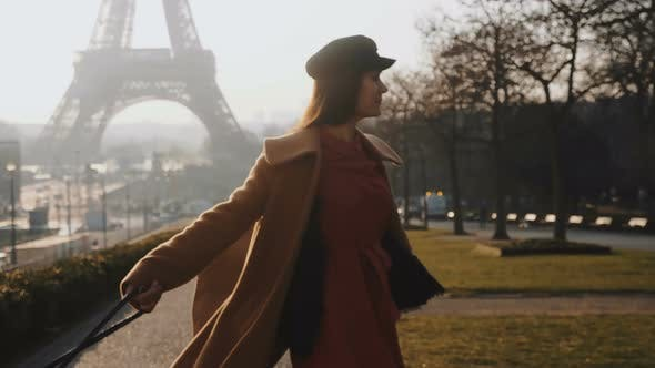 Thumbnail for Camera Follows Happy Cheerful Beautiful Woman Walking, Spinning at Epic Sunny Paris Eiffel Tower on