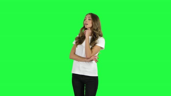 Cover Image for Lovable Girl Communicates with Someone in a Friendly Manner. Green Screen