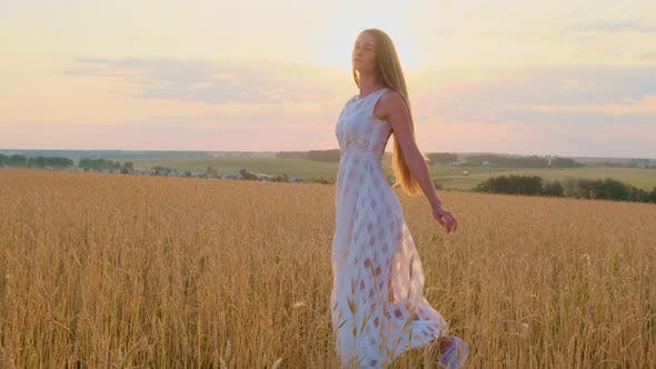 Thumbnail for Beautiful Woman in Dress at Sunset in a Wheat Field