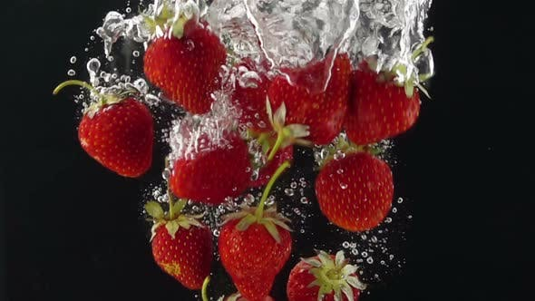 Thumbnail for Ripe Strawberries Falling through the Water