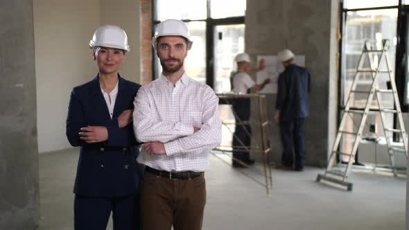 Confident Interior Designers Posing on Work Place
