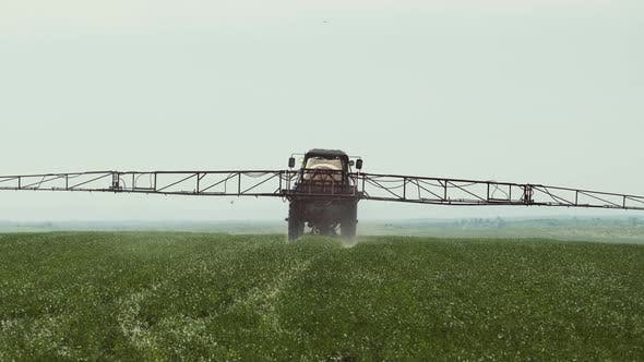 Thumbnail for Tractor With A Sprayer Work In The Field.