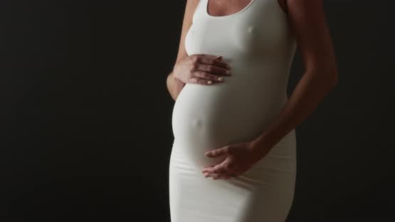 Beautiful pregnant woman dancing
