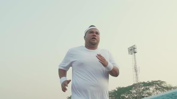 Tried Fat Man Running For Exercising At Stadium