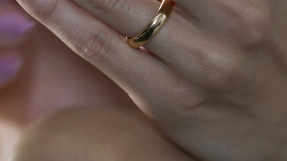 Thumbnail for Woman nervously twisting engagement ring in hands talking with psychologist