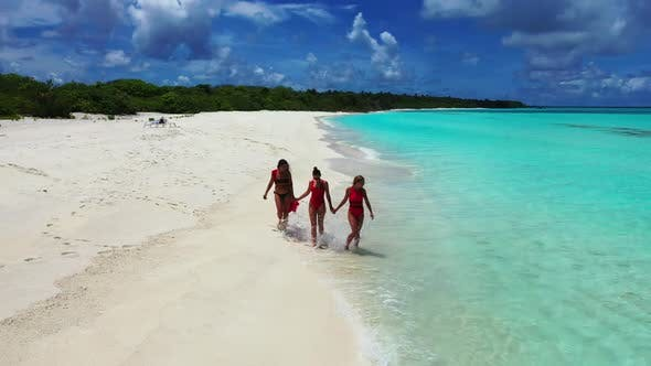 Ladies together happy together on luxury coastline beach voyage by clear sea and white sand backgrou