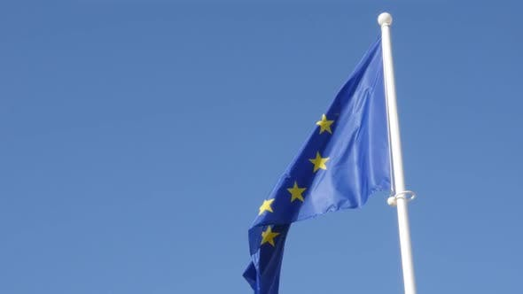 Thumbnail for Blue  yellow with stars European Union flag waving on wind in slow motion 1920X1080 HD footage - Eu