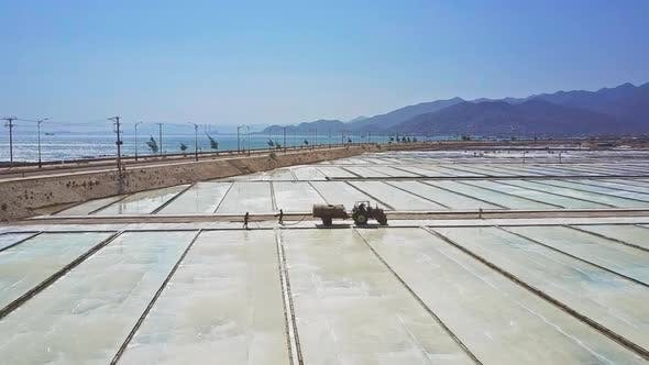 Tractor Drives Between Sites of Salt Plantations