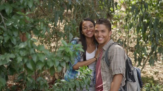 Good looking hispanic couple smiling outdoors