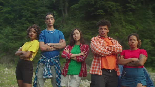 Confident Attractive Diverse Multiracial Backpacker with Arms Crossed Posing at Campsite