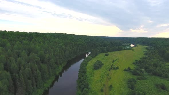 Thumbnail for Flying Over River And Forest In Evening