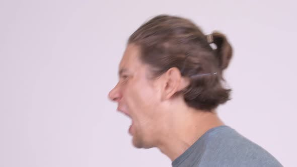 Thumbnail for Head Shot Profile View of Angry Man Talking and Shouting
