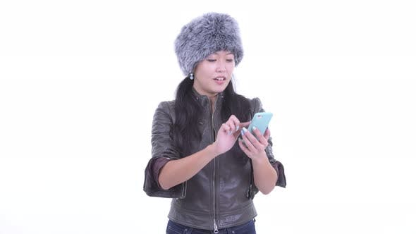 Thumbnail for Happy Beautiful Asian Woman Using Phone