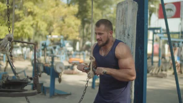 Athlete Training Triceps Pushdown Exercise Outdoor