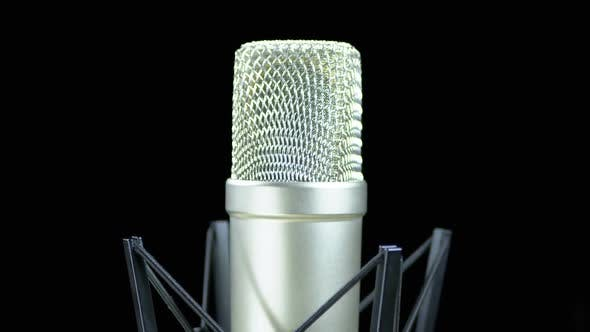 Cover Image for Studio Microphone with Spider Rotates on a Black Background