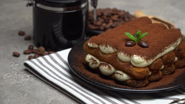 Thumbnail for Classic Tiramisu Dessert and Coffee Grinder on Ceramic Plate on Concrete Background