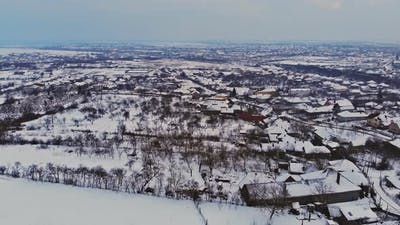 Drone high altitude snow covered old style house architecture winter snow