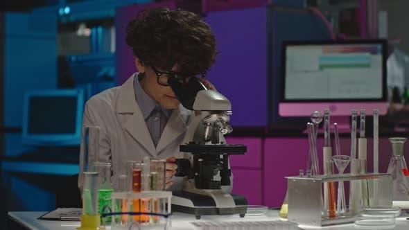 Thumbnail for Female Scientist Studying Sample
