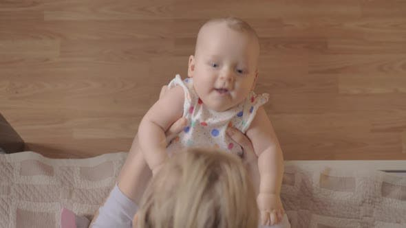 Thumbnail for Mother Playing with Her Newborn Daughter