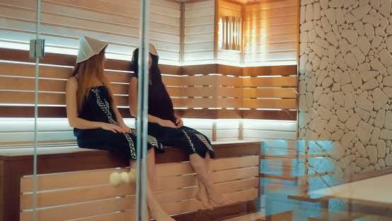 Beautiful Girlfriends Talk in the Sauna