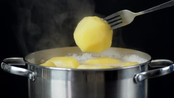 Welded in the Pan the Potatoes on a Fork.