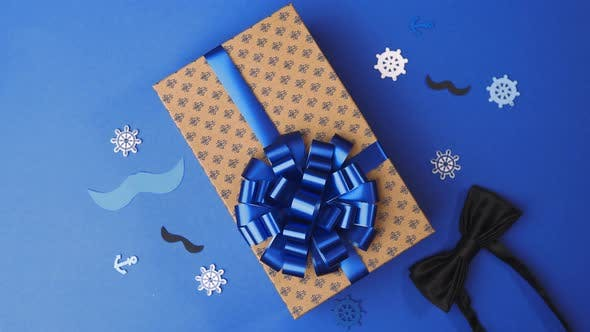 Thumbnail for Gluing the Bow To the Present Box for Men, Wrapping the Present, Parcel Decoration, Box with