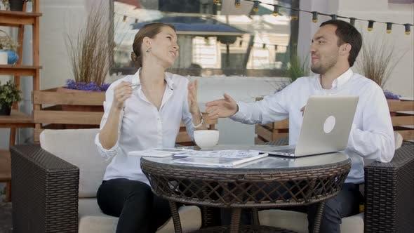 Thumbnail for Bbusinessmen Shaking Hands in Cafe