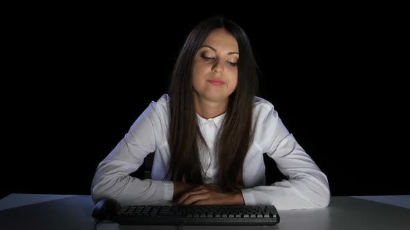 Thumbnail for Girl Was Tired, Almost Asleep in Front of a Computer