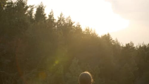Girl Meditates in Open Nature