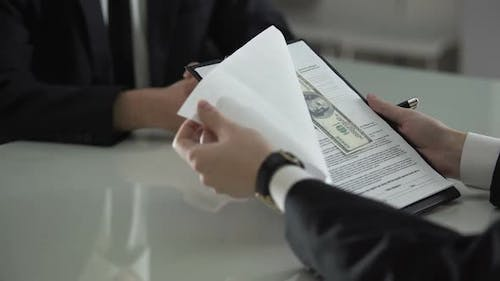 Man Signing Contract Seeing Money Between Pages, Bribe, Prosperity of Corruption
