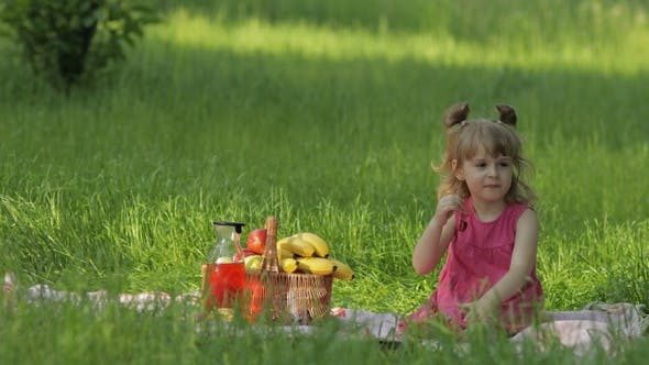 Thumbnail for Weekend at Picnic. Lovely Caucasian Child Girl on Green Grass Meadow Eating Merry, Cherry