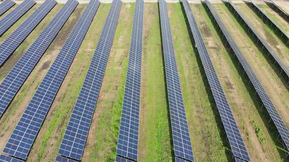Cover Image for Aerial View of Solar Power Station. Solar Farm. Field of Solar Panels in a Row