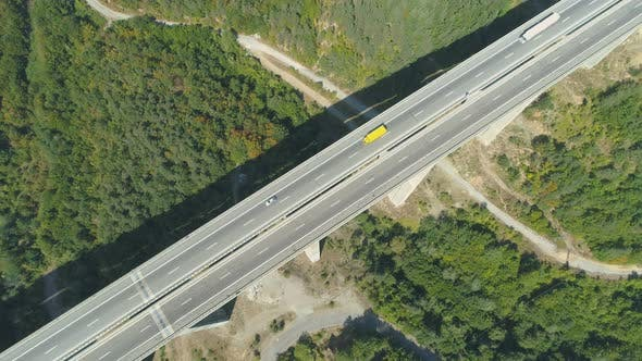 Thumbnail for Top View of Highway Bridge with Yellow and White Truck Driving Along