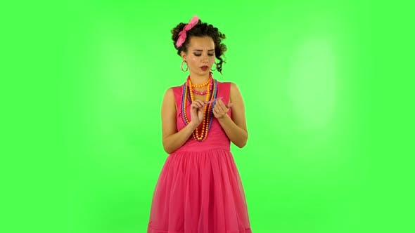 Thumbnail for Girl Makes Herself Manicure with Pink Nail File on Green Screen at Studio