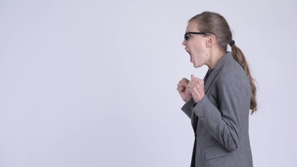 Cover Image for Profile View of Young Angry Businesswoman Shouting and Screaming
