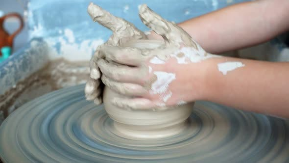 Thumbnail for Little Girl Is Molding at Pottery Wheel Creating a Clay Bowl, Dirty Kid's Hands