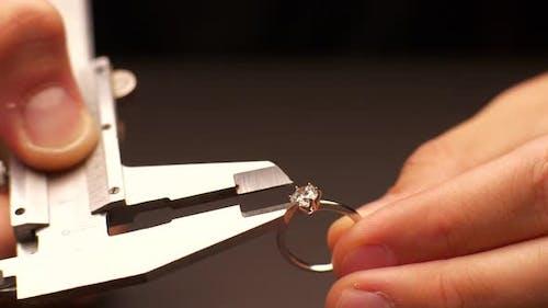 Man Measures Diameter of Diamond in Ring