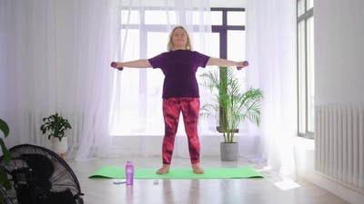Fitness Training Blonde Overweight Woman Doing Fitness Exercises Standing on Yoga Mat and Training