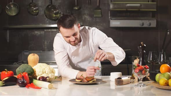 Portrait of Chef Looking Straight To the Camera in Kitchen He Enjoying the Time at His Workplace