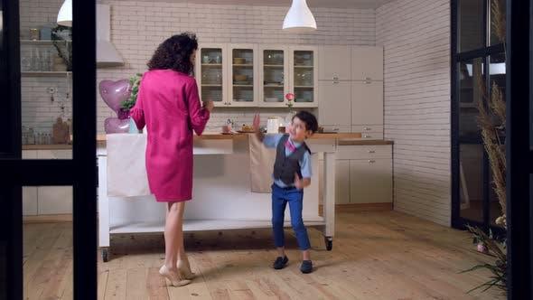 Thumbnail for Joyful Mixed Race Family Dancing in the Kitchen